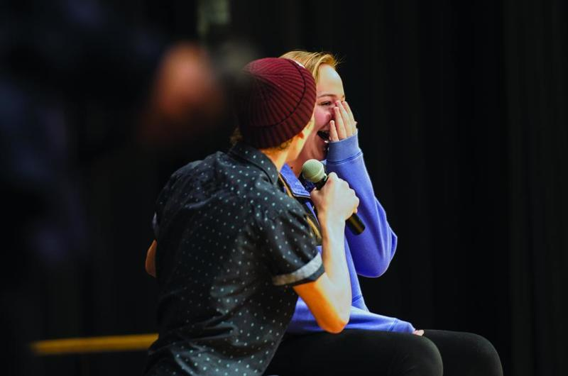 Landon singing to Morrison High School student Emma Peppers during a lighter moment of the MWAH! presentation.