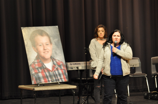 The mother of Joshua Wilson, Jennifer Higgins of Geneseo, Illinois, speaks about the unexplained loss of her son when he was 12. Also shown is MWAH! troupe member Jade Parr, also of Geneseo, who told of her own struggles in living in two houses following her parents' divorce and the suicide of her grandfather.